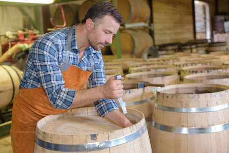 cooper: Cooper making barrel