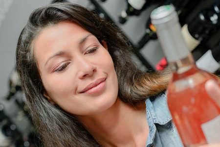 girl holding a bottle of wine Stock Photo