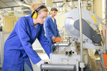 qualified worker: young qualified people forced to work at the factory