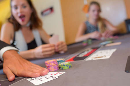casino table: Adults around casino table