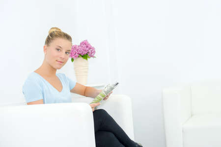 fale: Woman reading in a waiting room Stock Photo