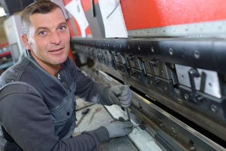 heavy machinery: fixing a heavy machinery Stock Photo