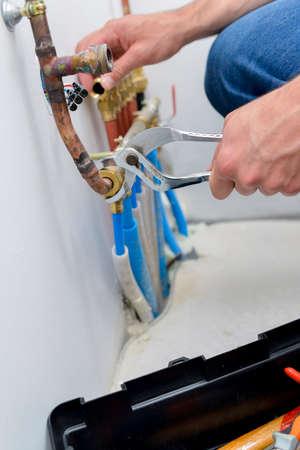 disconnecting: man fixing tube