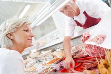 serf: woman buying sausage
