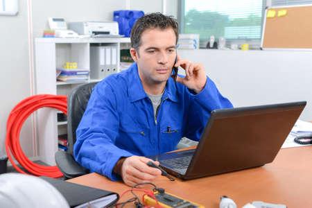 Builder sat in his office