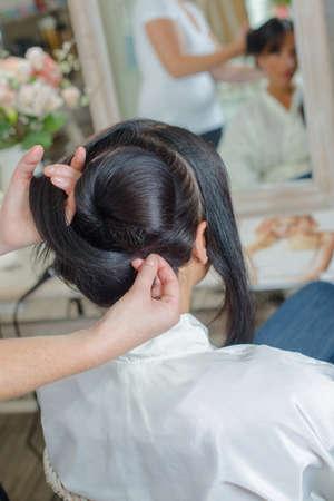 styler: girl having a hair service