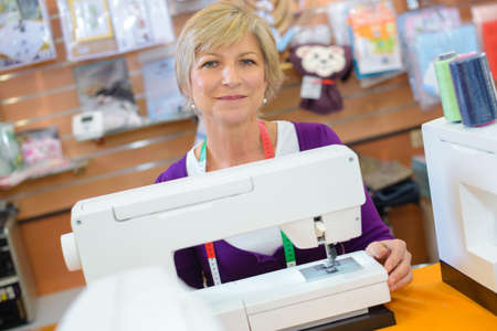 dressmaker posing and smiling Stock Photo