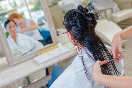 haircutting: woman in hair salon