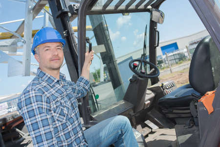 heavy equipment operator: forklift operator on the site Stock Photo