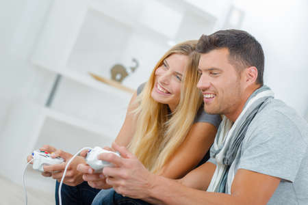 young wife: Young couple playing video games