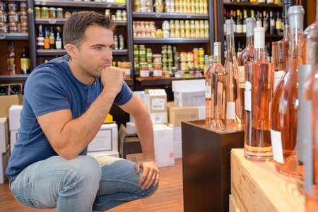 alcoholic drinks: buying alcoholic drinks Stock Photo