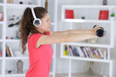 respite: young fitness woman in gym and listen music with headset