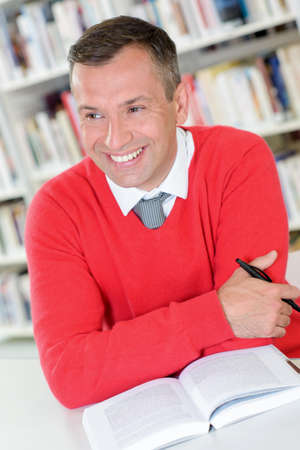 man in library Stock Photo