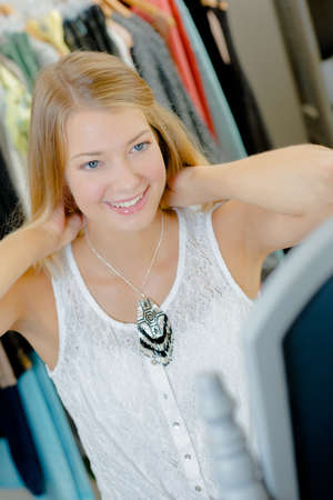 Woman trying on a necklace in a shop