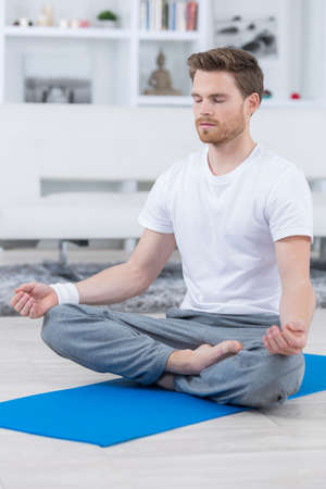 handsome dark haired man practicing yoga