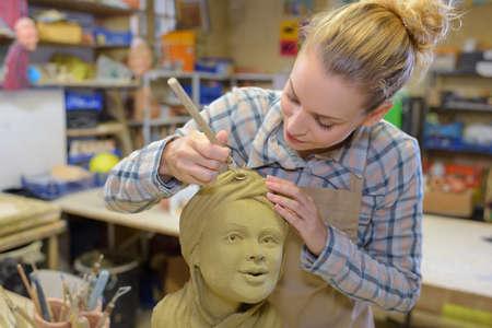 sculptor: Female sculptor at work Stock Photo