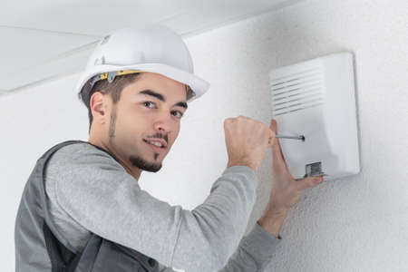 technology career: installing a device on the wall