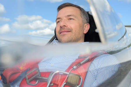 exhilaration: man inside the cockpit flying in glider Stock Photo