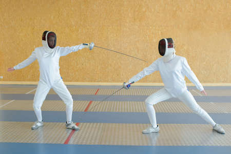 fencers: fencers doing the drill Stock Photo