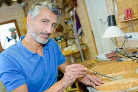 sculptor: an artisan in the workshop