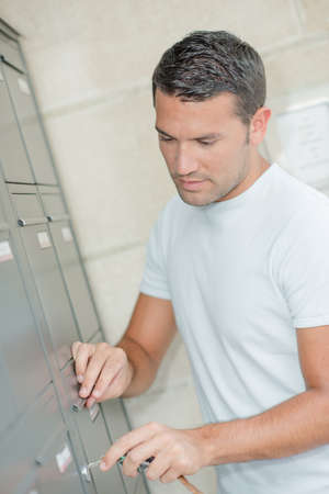 entry numbers: Man checking his letter box