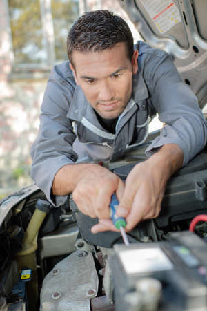 looker: fixing the engine Stock Photo