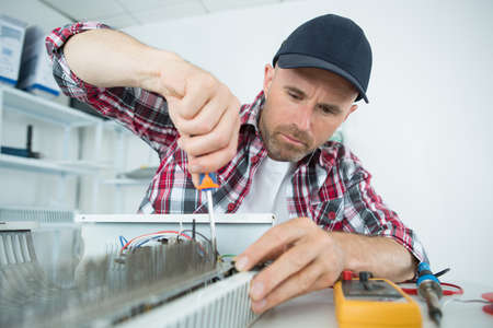 Electrician using screwdriver Stock Photo