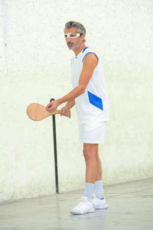 siervo: man playing pala Foto de archivo