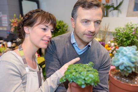 Florist advising customer Stock Photo