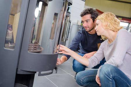 woodburner: Young couple looking at woodburners