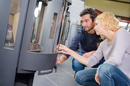 woodburning: Young couple looking at woodburners