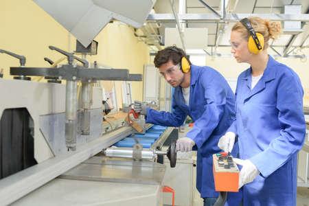 school work: young metallurgists at work in school workshop