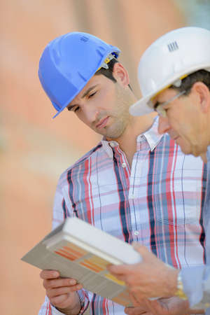 foreman: Foreman and colleague on site Stock Photo