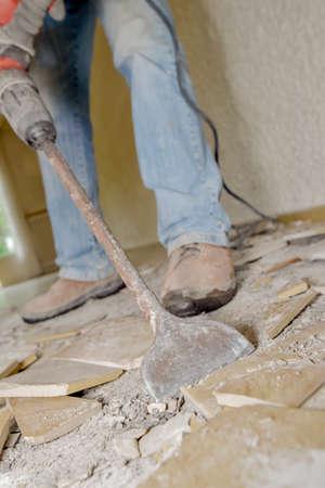 tile cutter: Smashing floor tiles