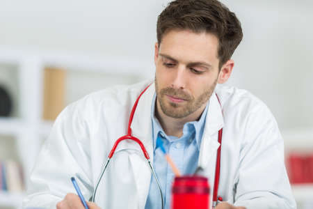 appoint: doctor appoint prescription drugs to patients Stock Photo