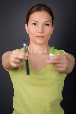 e-cigarette in womans hand