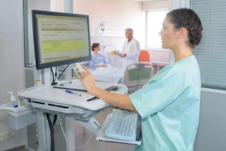 computerised: Nurse using computer