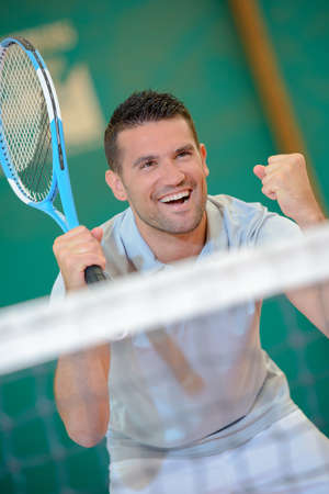 competitive sport: Tennis player making gesture of victory