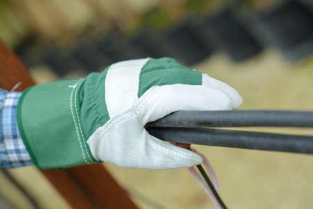 man wearing garden gloves
