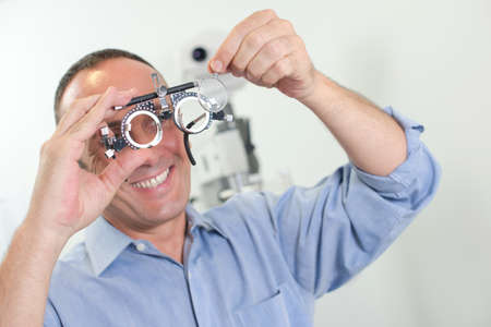 optician: Optician holding eyetest glasses Stock Photo