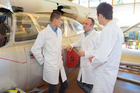 aerospace: aerospace engineers having a conversation