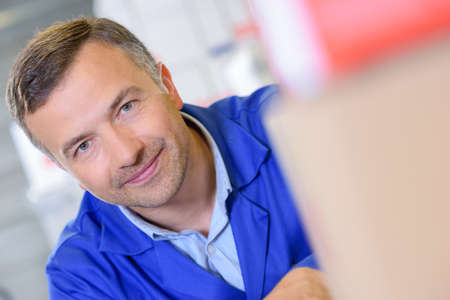 laborer: laborer posing in the workshop Stock Photo