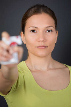 crushing: woman crushing a packet of cigarettes