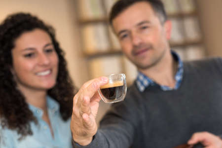 appraising: Couple appraising coffee in cup Stock Photo