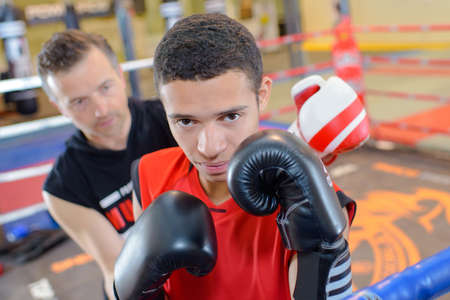 Young man in boxing ring