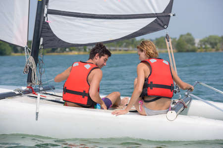 lifevest: couple going sailing