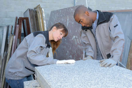 order shipment: tile setters inspecting a delivery