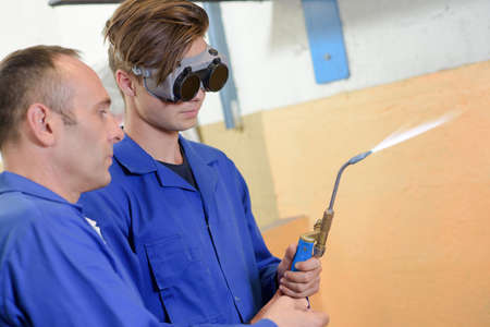 young welder with a teacher Stock Photo