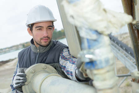 watertight: pipe fitter checking the connections Stock Photo
