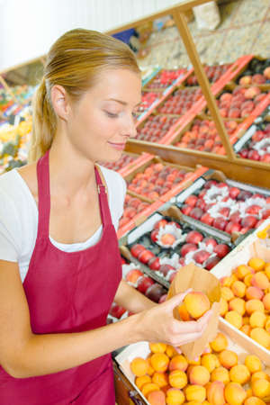 dirty blond: Fruit stall worker